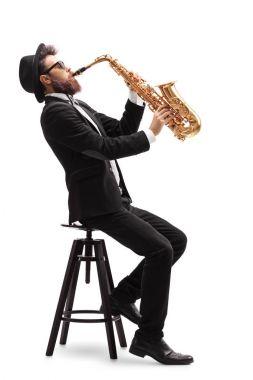 Jazz musician playing a saxophone