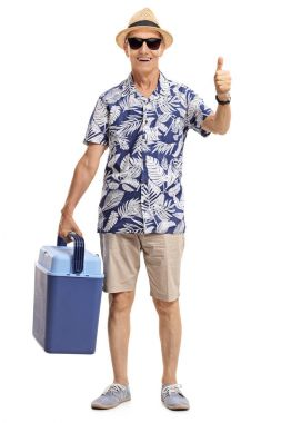 tourist with a cooling box making thumb up gesture