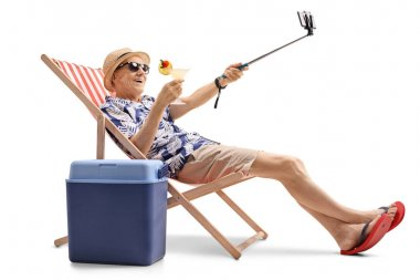 elderly tourist with a cocktail taking a selfie