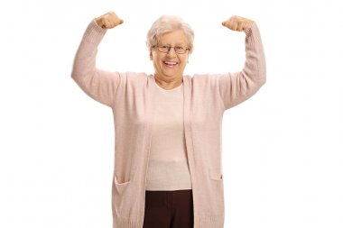 Cheerful mature woman flexing her muscles