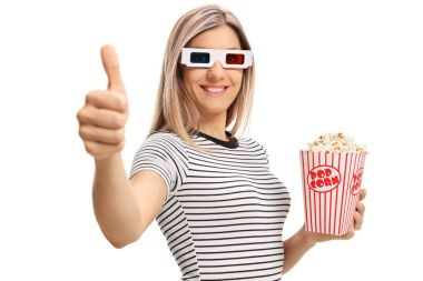 Young woman with 3D glasses and popcorn making a thumb up gesture isolated on white background stock vector