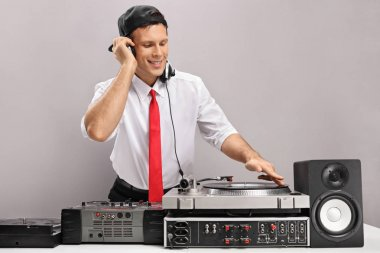 guy playing music on a turntable