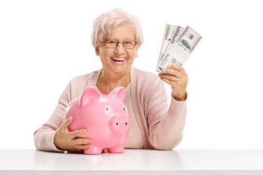 elderly woman with a piggybank and money bundles