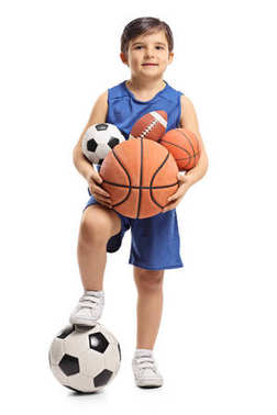 boy holding different kinds of sports balls