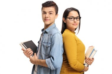 students with books with their backs against each other