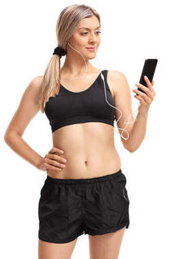 Young woman in sportswear using a phone