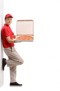 pizza delivery boy against a wall