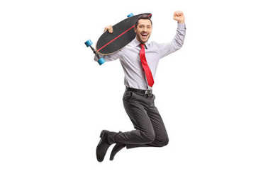 Businessman with a longboard jumping and gesturing happiness