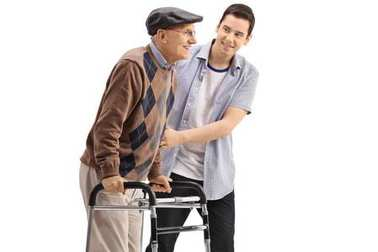 Young guy helping a senior with a walker