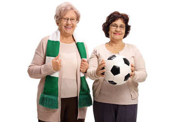 Elderly female soccer fans with a scarf and a football isolated on white background