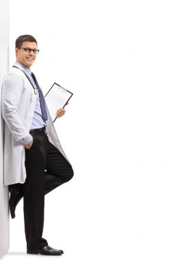 Full length portrait of a doctor leaning against a wall isolated on white background stock vector