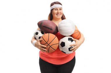 Overweight woman holding different kinds of sports balls isolated on white background