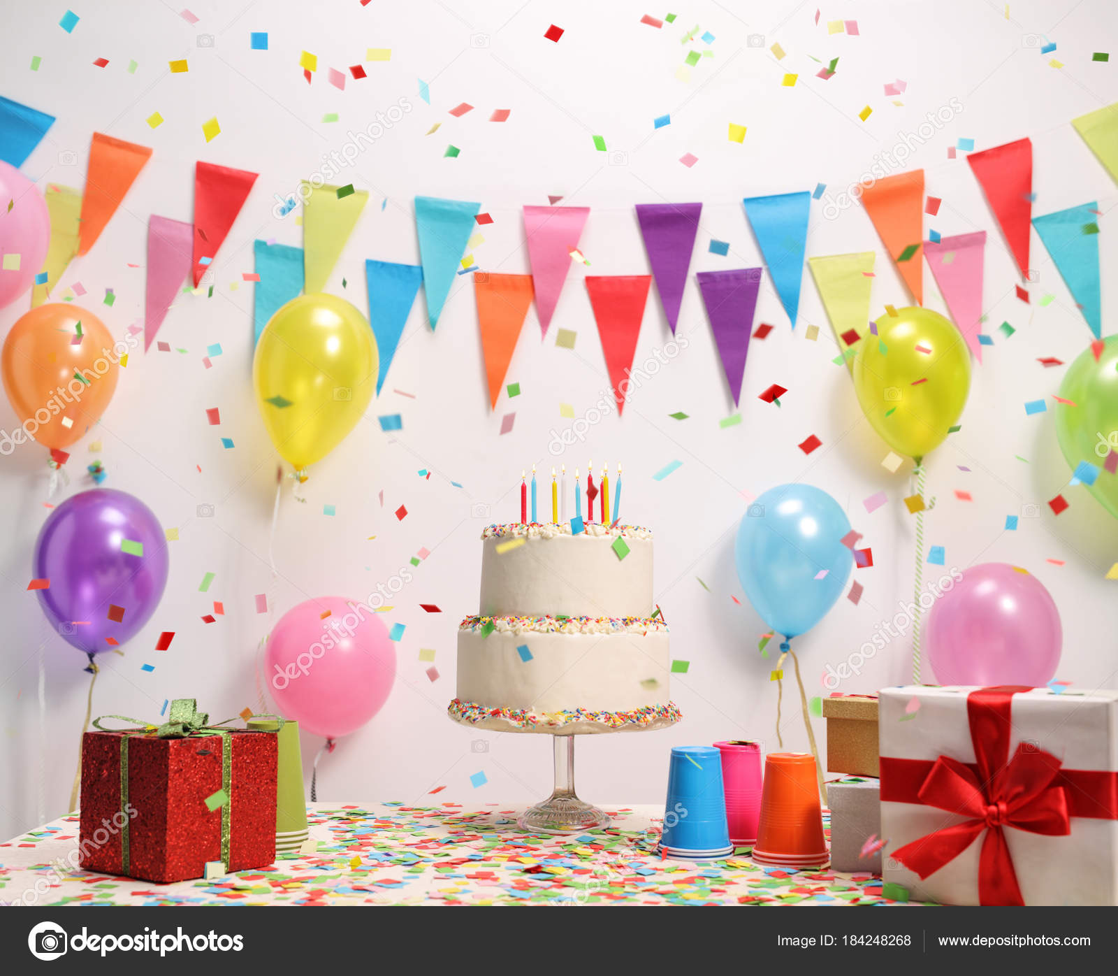 Birthday Cake On A Table Against Wall With Decoration Flags And Balloons Photo By Ljsphotography