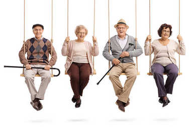 Cheerful seniors sitting on wooden swings and looking at the camera isolated on white background