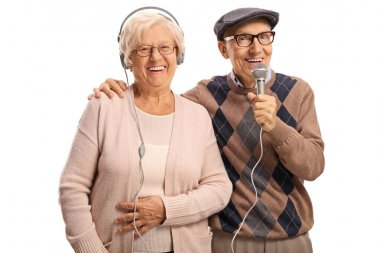 Elderly woman with headpones and an elderly man with a microphon
