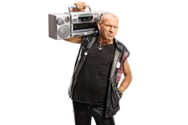 Grumpy punker carrying a boombox radio on his shoulder