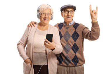 Elderly man and woman listening to music and gesturing a rock an