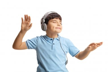 Cute little boy dancing with closed eyes and listening to music