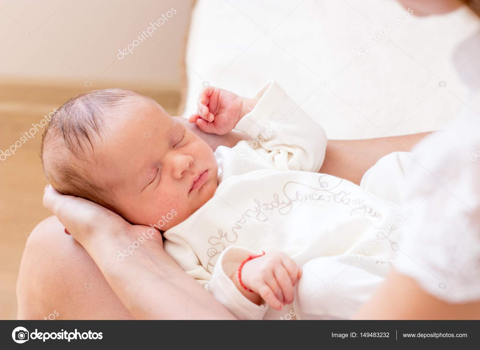Beautiful delicate picture of the child and mother photo legs handles baby closeup lovely babys legs newborns stock image