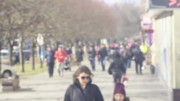 Defocused street with walking crowd. Slow motion crowd. crowd of people walking on city street