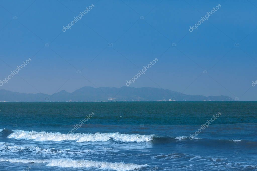 Seascape with surf in bay