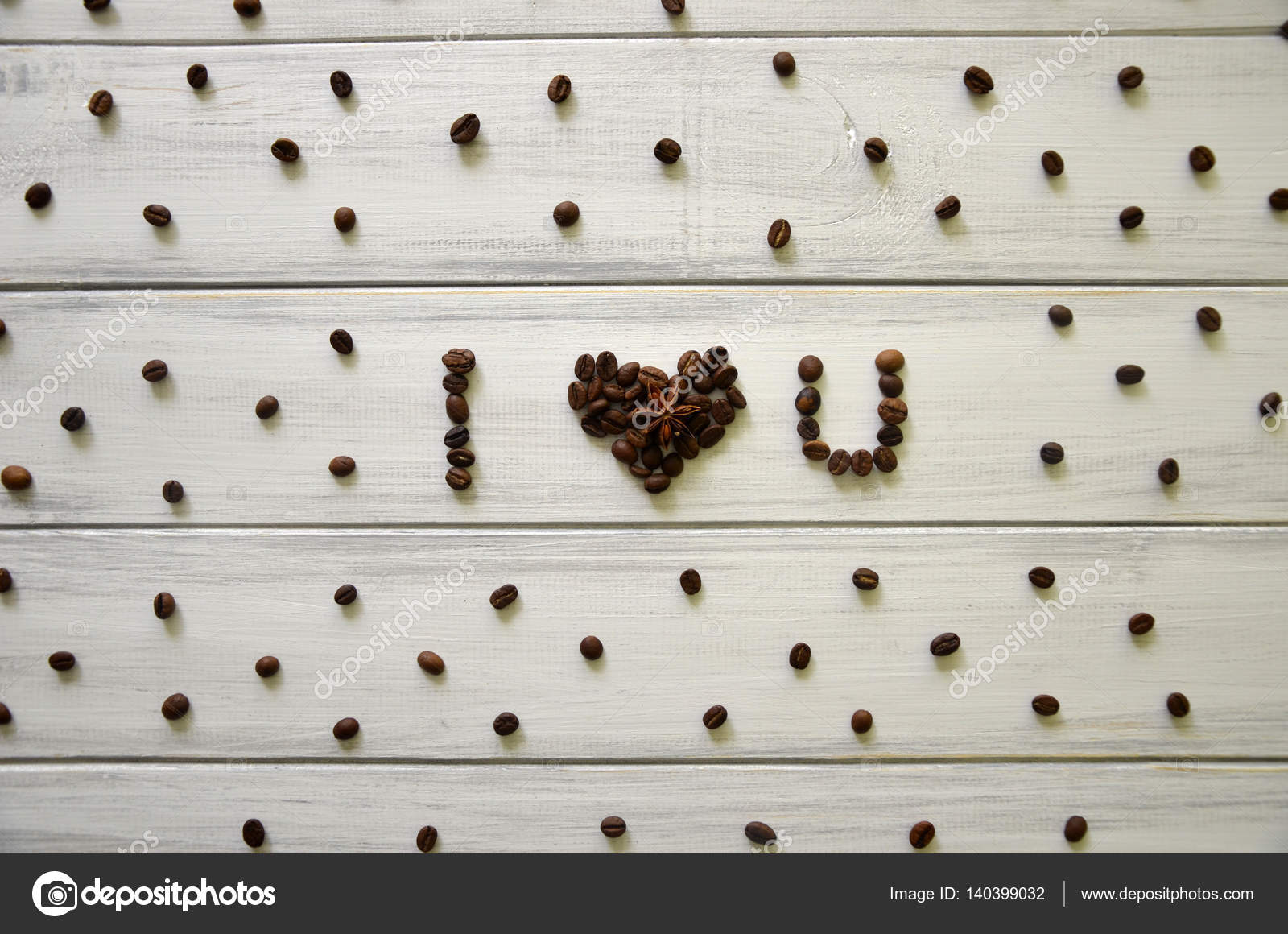 top view of i love you i heart u words made from coffee beans on