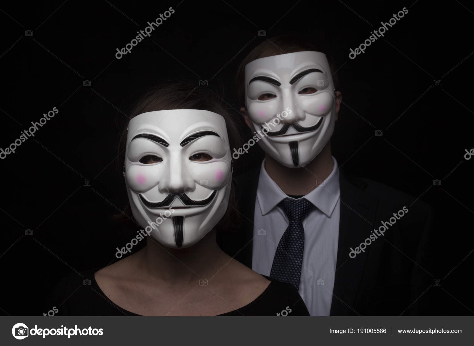 Two members of anonymous activist hacker group with mask