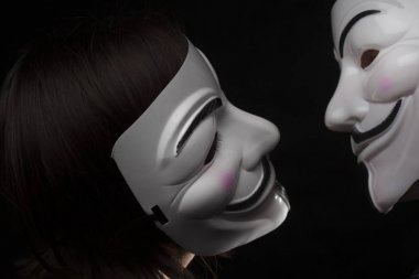 two members of anonymous activist hacker group with mask studio