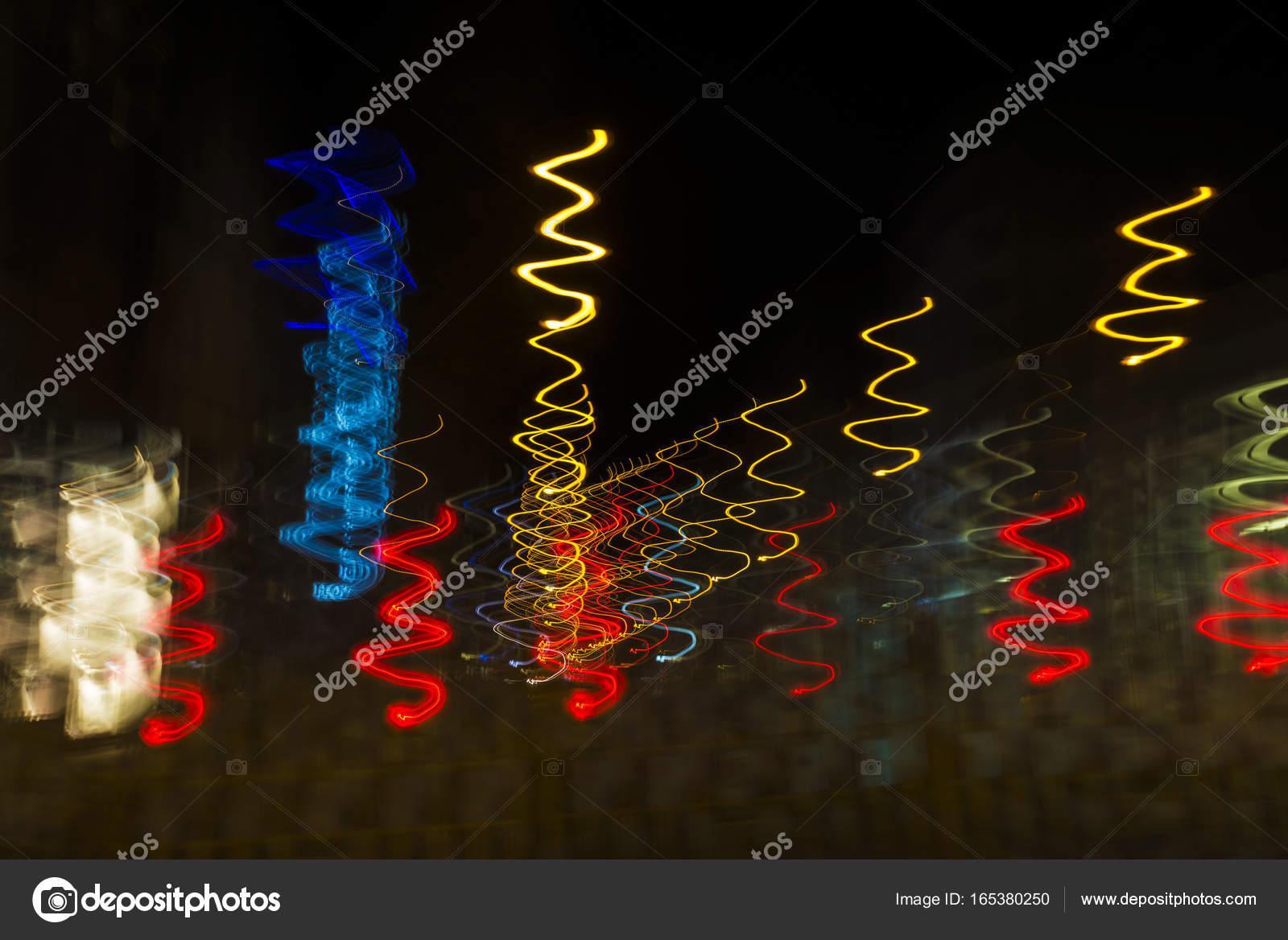 Luces De Colores En Movimiento De Espiral En La Noche Como Backgrou