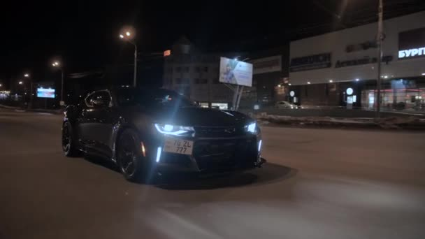 TOMSK, RUSSIA - March 30, 2020: Chevrolet Camaro ZL1 the Exorcist rides on the road at night front view