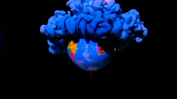 Blue planet earth from space. Blue and white watercolor ink in water on a black background. Ecology and the environment. Save the planet. Ecological catastrophe.