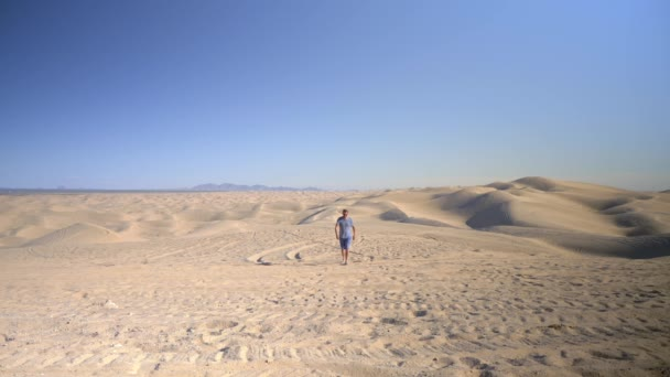 Man walking through Imperial Sand Dunes, Algodones Dunes, California