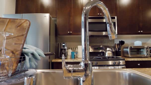 Close Up of Kitchen Faucet and Clean Dishes in Modern Home, Slow motion