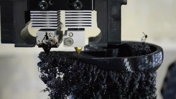 Print black details on the printer 3D close-up.
