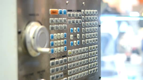 Large button on the control panel industrial machine close-up.