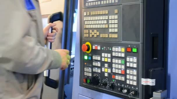 man working on the control panel works with an industrial machine