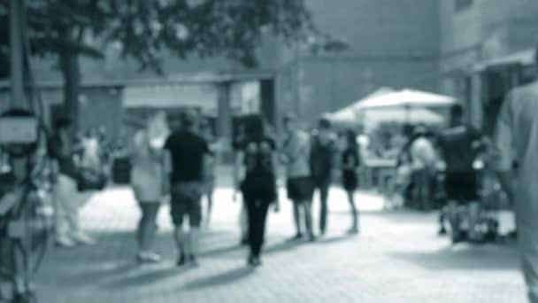People walk on the street. Background blur