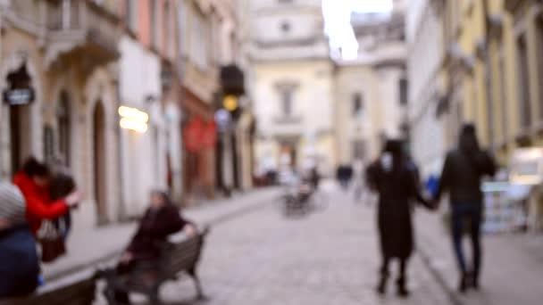 Abstraktní rozostřené rozmazané pozadí mnoha lidí na ulici