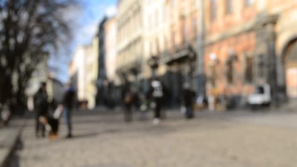 Rozmazané pozadí mnoha lidí na ulici náměstí staré starobylé město