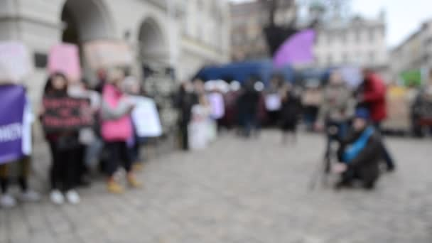 Blurred background People are standing in the square in protest.