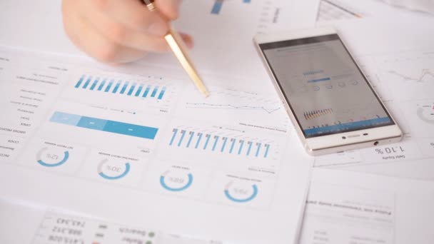 Investment Charts And Stock Statistics man hand chek a financial trading report close-up