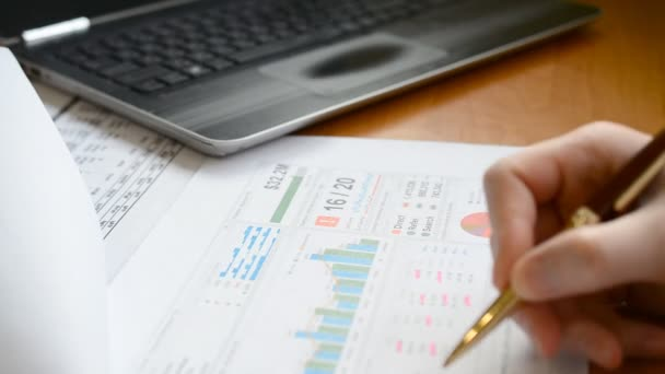 Financial manager looking her business project and analyzing market data