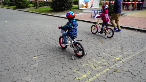 LVIV, UKRAINE - SEPTEMBER 21, 2019: Children s cycling in the city park. Slow motion.
