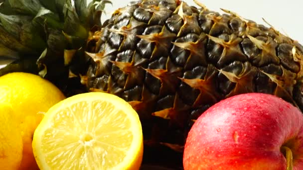 Still life from pineapple, apples and lemons. Healthy food.
