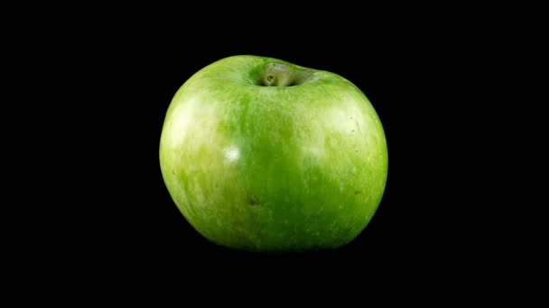 Apple on a black background.