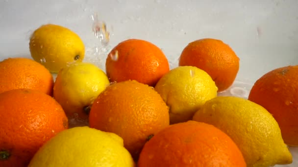 Juicy oranges and lemons and splashes. Slow motion.