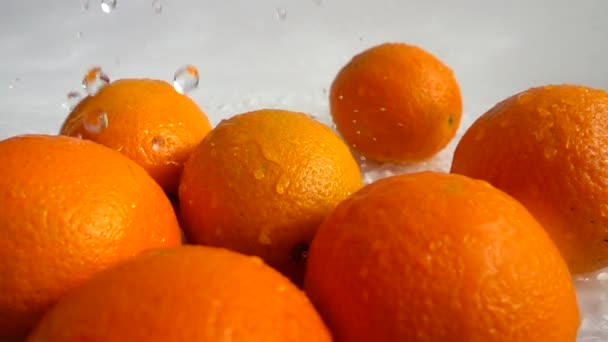 Juicy oranges and splashes. Slow motion.