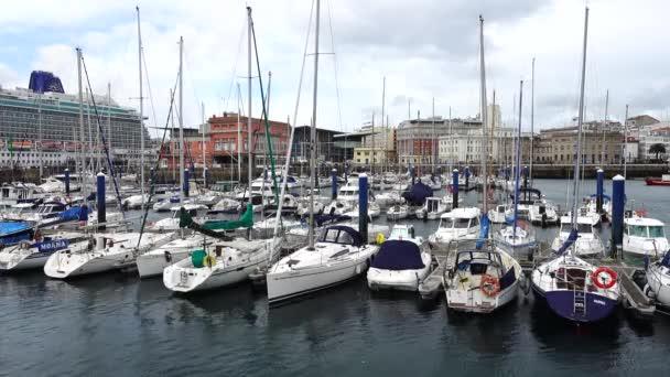 The embankment and yachts in La Coruna. LA CORUNA, SPAIN - APRIL 1, 2018: The embankment and yachts in La Coruna.La Coruna the large city in the northwest of Spain, the resort and the port.