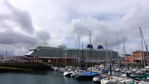 LA CORUNA, SPAIN - APRIL 1, 2018:The cruise liner and yachts in port. Timelapse. Britannia cruise liner. La Coruna the large city in the northwest of Spain, the resort and the port. Timelapse.