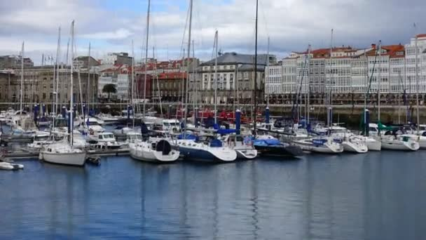 LA CORUNA, SPAIN - APRIL 1, 2018: The embankment and yachts in La Coruna. La Coruna the large city in the northwest of Spain, the resort and the port. Timelapse.